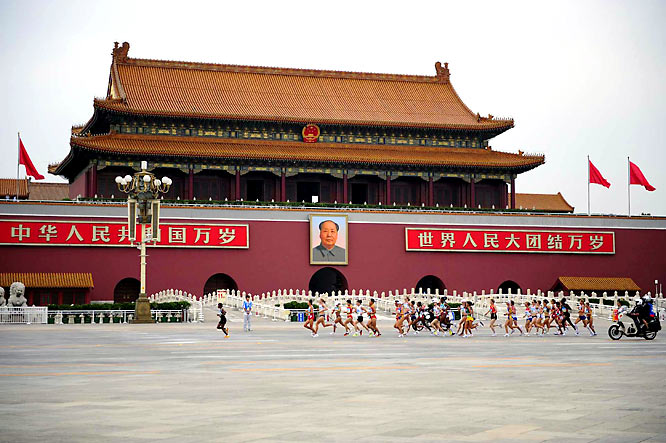 Runners pass Mao Zedong's mausoleum in Tiananmen Square at the start of the women's marathon.