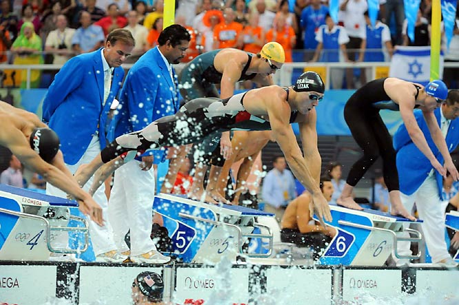 Jason Lezak, the oldest man on the US swimming team at 32, dives to begin the anchor leg.