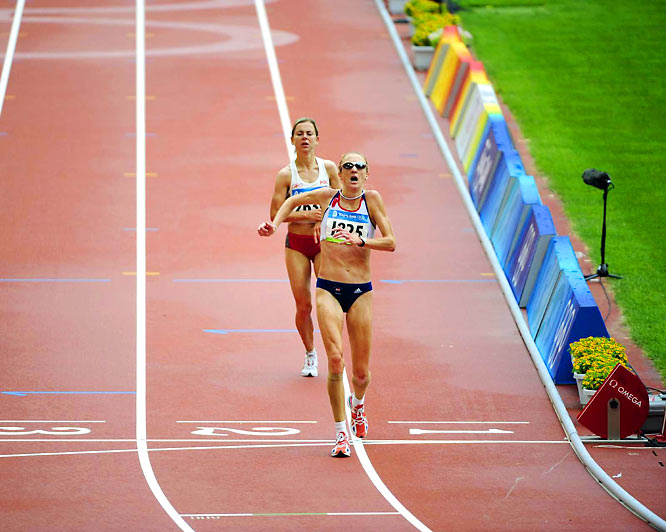Britain's Paula Radcliffe looked determined to complete the distance and, limping, she was given a great ovation by the crowd as she finished 23rd in 2:32.38, 17 minutes slower than her best.  It was a brave attempt by the world record holder who was hoping to erase the agony of Athens four years ago when, as the big favorite, she failed to finish, her race ending slumped on the pavement 6 km from the finish.