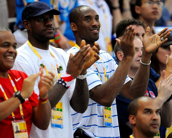 LeBron James and Kobe Bryant applaud the US team during the medal ceremonies.