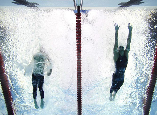With less than a meter to go, Phelps still trailed Cavic and his only hope was to somehow out-touch the Serbian.