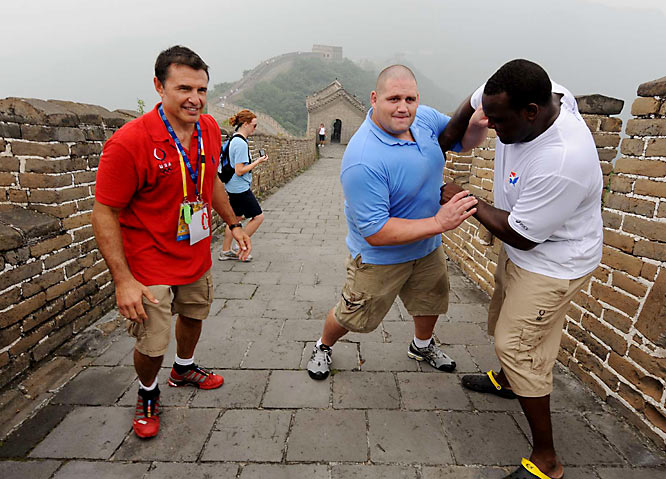 U.S. wrestler Dremiel Byers and former wrestler Rulon Gardner on the Great Wall of China.