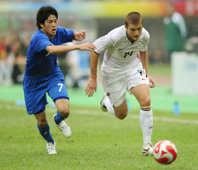 Robbie Rogers of the U.S. attempts to pull away from  Atsuto Uchida.