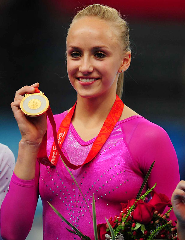 Liukin now has a gold medal to go with the two her father won as a member of the Soviet Olympic team of 1988.