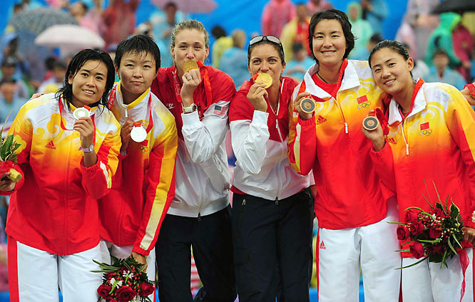 The Americans kissed gold while surrounded by the silver- and bronze-winning Chinese teams.