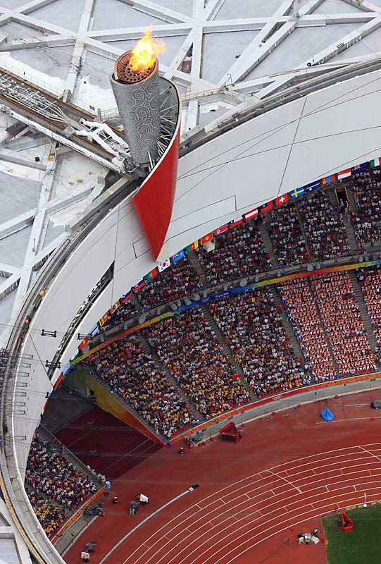 The Olympic flame above the Birds Nest stadium.