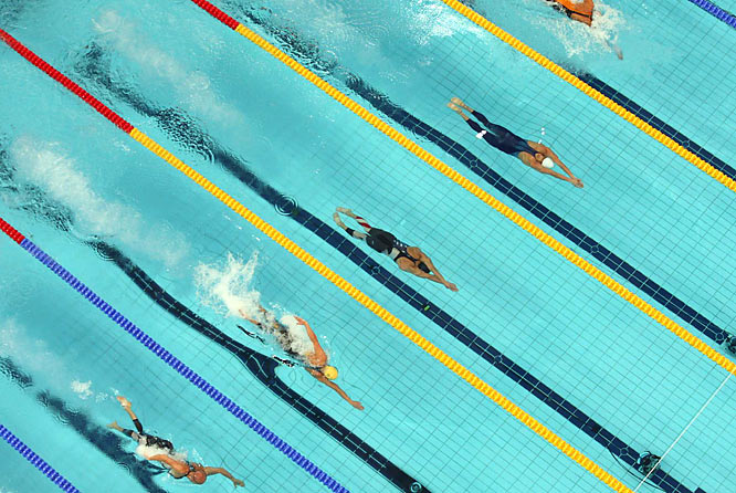 Michael Phelps (center lane) at the start of the 4x100 freestyle relay final.