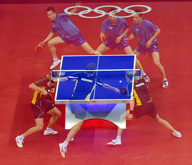 Table tennis action.