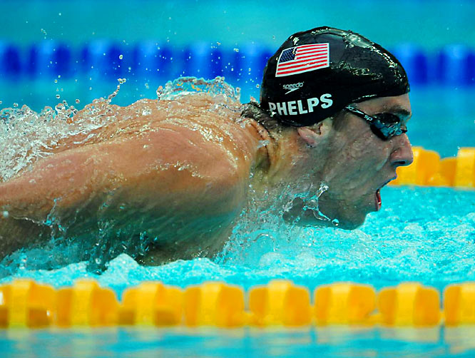 Michael Phelps won his fourth gold in the 200m butterfly with a new world record time of 1:52.03, despite looking sluggish and having his goggles fill with water.