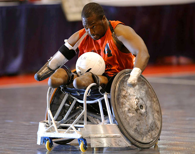 Delvin McMillian, 28, a retired airman from Bessemer, Ala., spins away from his pursuers in a quad rugby game at the 28th National Veterans Wheelchair Games, held July 25 through 29 in Omaha.<br><br>The National Veterans Wheelchair Games are a multi-event sports and rehabilitation program for military service veterans who use wheelchairs for sports competition due to spinal cord injuries, amputations, or certain neurological problems.  Attracting more than 500 athletes each year, it is the largest annual wheelchair sports event in the world.