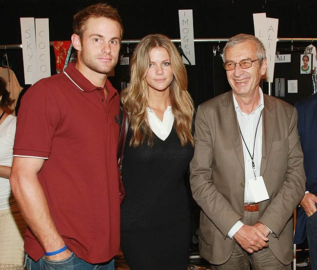 Tennis star Andy Roddick and his fiancee, SI swimsuit model Brooklyn Decker, pose with Lacoste president Michel Lacoste backstage at the Lacoste Spring show