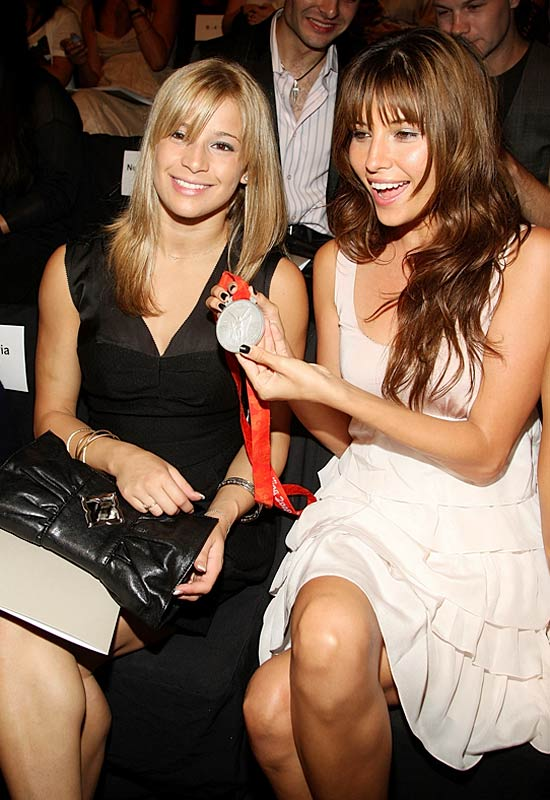 Gymnist Alicia Sacramone (left) showed off her olympic medal to actress Tamara Feldman during the BCBG Max Azria show
