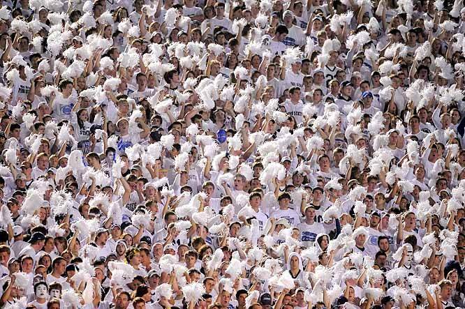 Penn State stuck with its traditional blue home jerseys, but that didn't stop its fans from wearing the most white they could find for this year's Penn State White Out. PSU gave its wig-wearing, pom-pom-carrying fans plenty to cheer about with a 38-24 win over Illinois. Did the PSU faithful out-do Georgia's fans? Scroll through to decide.