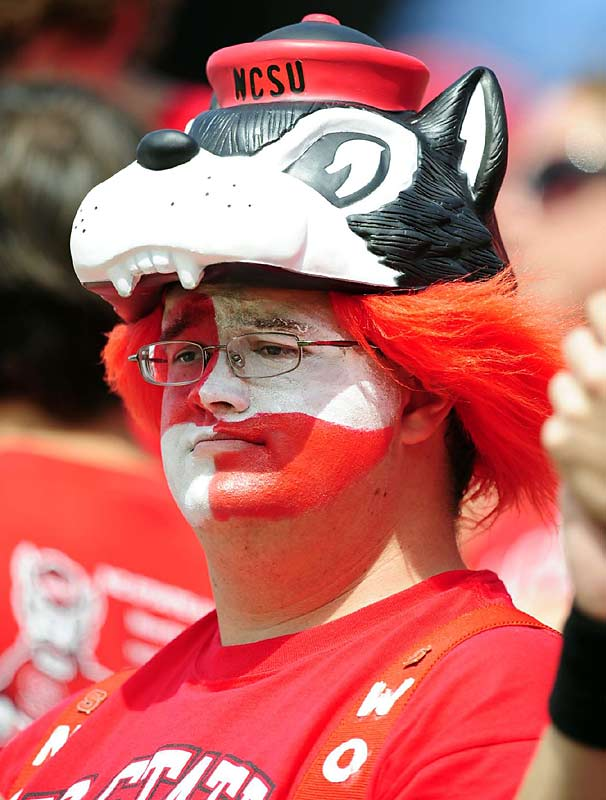 An N.C. State overtime victory and a good look in the mirror probably put the smile back on this fan's face.