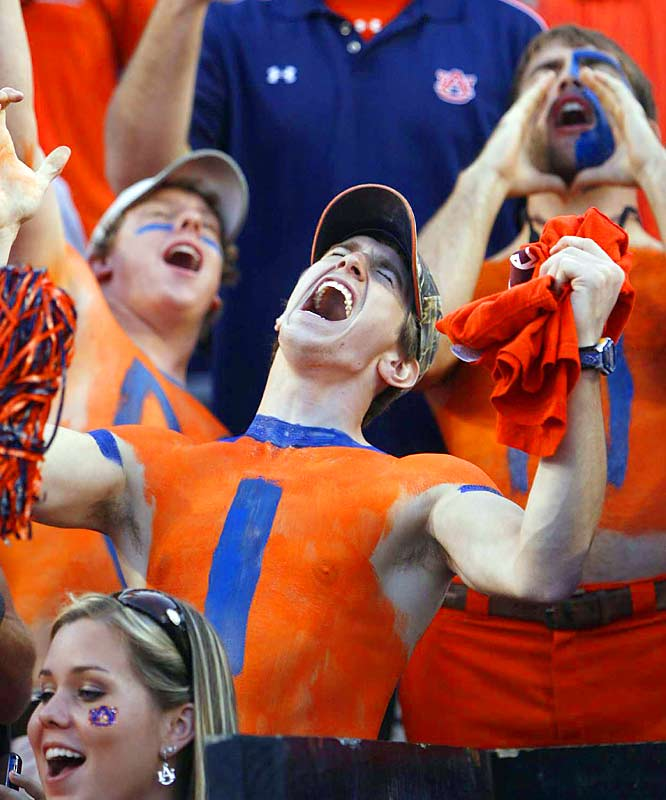 It's hard to tell if this Auburn fan is cheering on his Tigers, or mourning their last-minute loss to rival LSU.