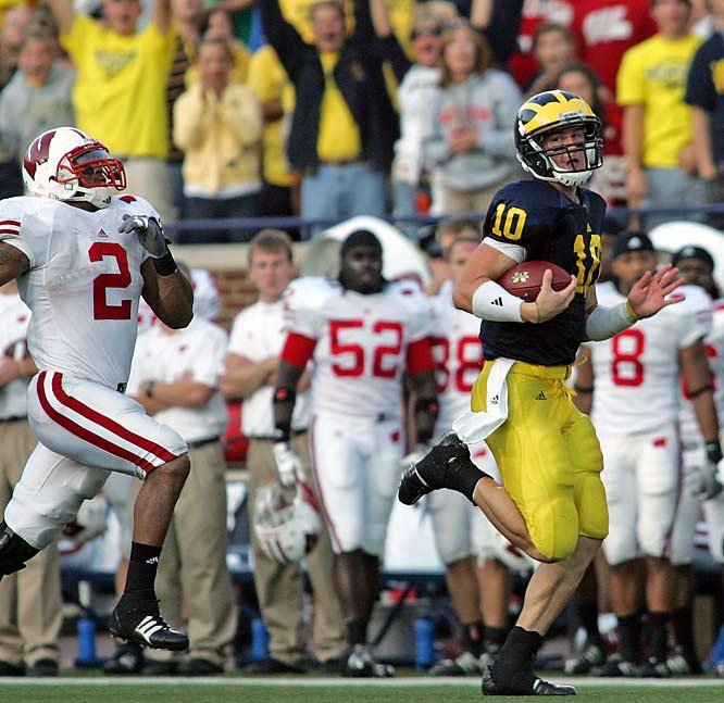Michigan quarterback Steven Threet (10) breaks downfield for a 58-yard run as Wisconsin linebacker Jonathan Casillas (2) and defensive back Allen Langford (17) chase during the fourth quarter of the Wolverines upset win.