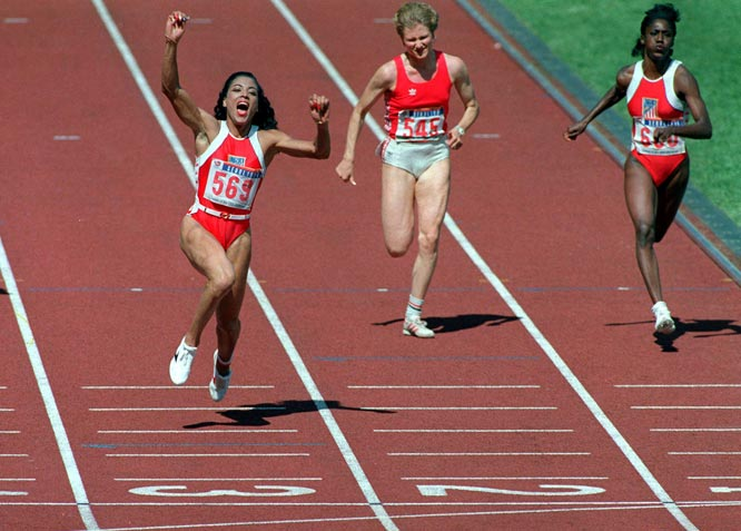 Florence Griffith Joyner claims gold by winning the 100 meter dash in an Olympic record 10.54 seconds.