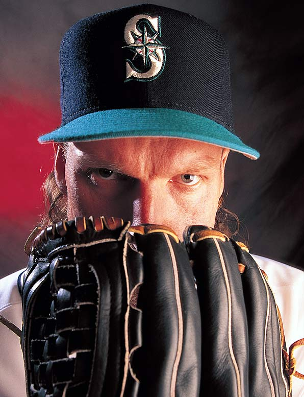 By striking out 13 A's in 10 innings of a 3-2, extra inning loss, Randy Johnson becomes the 12th pitcher this century to strike out 300 batters in a season.