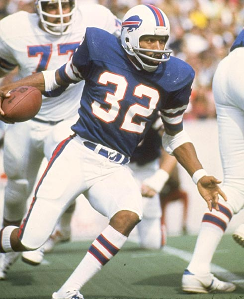 Buffalo's O.J. Simpson rushes for a then-NFL record 250 yards in Buffalo's 31-13 victory at New England.