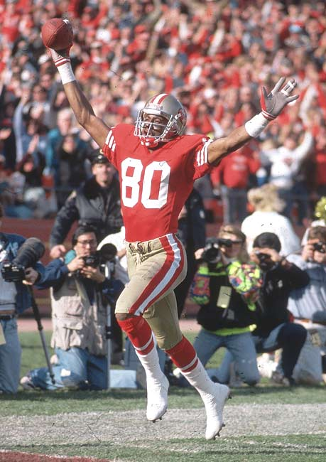 San Francisco's Jerry Rice catches a pair of scoringpasses and runs in a 23-yard reverse to become the NFL's career touchdown leader with 127.