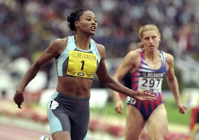 Marion Jones completes an undefeated season, 35-for-35,winning the long jump and the 100 meters an hour apart at the IAAF Grand Prix Finals in Moscow.