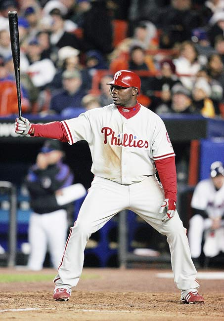 Philadelphia's Ryan Howard belts three home runs and becomes the first Phillies player to hit 50 home runs in a season.
