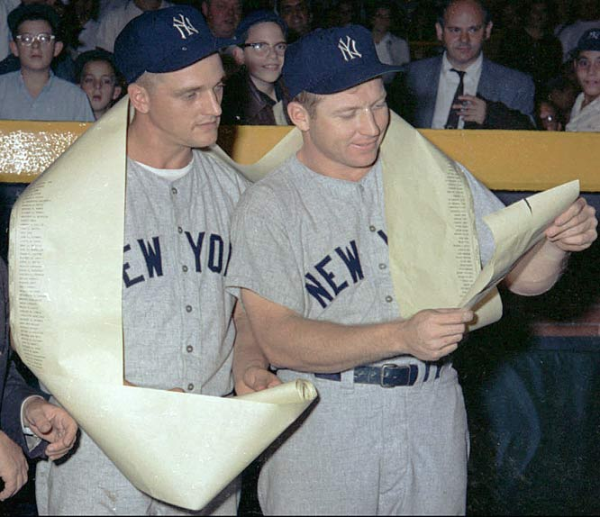 Yankees outfielders Roger Maris (left) and Mickey Mantle become the first teammates to hit 50 home runs in the same season. Maris would finish the year with an MLB record 61 round-trippers while Mantle finished with 54.