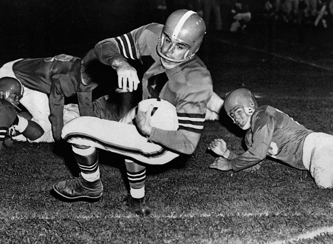 The Northwestern grad guided the Cleveland Browns to 10 division or league crowns in 10 years from 1946-1955. He retired in 1955 with 23,584 passing yards and 174 TDs.