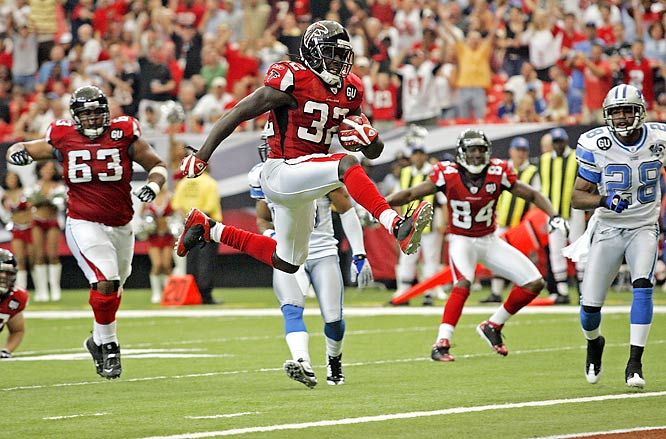 Jerious Norwood leaps into the end zone for a touchdown in the third quarter of the Falcons' 34-21 victory over the Lions.  Atlanta dominated the game on the ground with Michael Turner's 220 yards on 22 carries, along with Norwood's 93 yards on 14 carries.