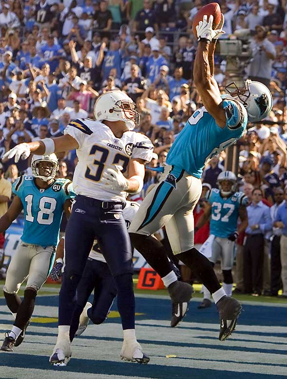 Tight end Dante Rosario leaps to catch the game-winning 14-yard touchdown pass over Chargers safety Eric Weddle as time expires.  Rosario led the Panthers with 7 catches for 98 yards in their 26-24 victory.