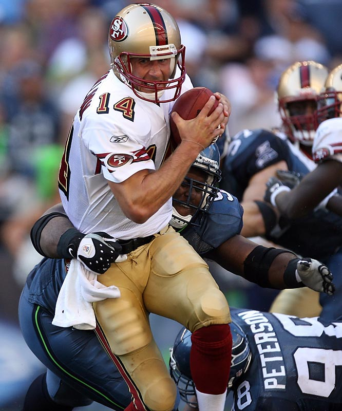 San Francisco's J.T. O'Sullivan shook off eight sacks to lead a comeback against Seattle.  The 49ers won 33-30 in overtime.
