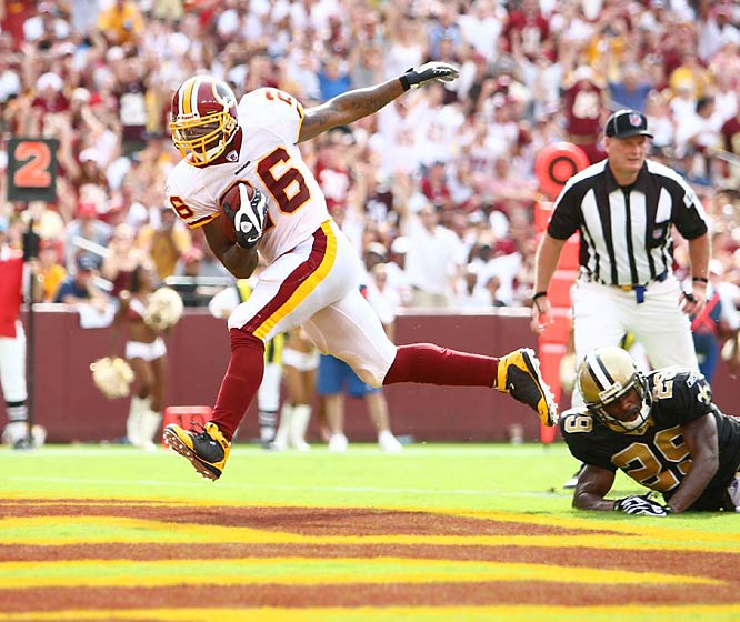 Redskins running back Clinton Portis carries the ball for an eight-yard, fourth-quarter touchdown as Saints safety Josh Bullocks is unable to make the tackle. Washington won 29-24.
