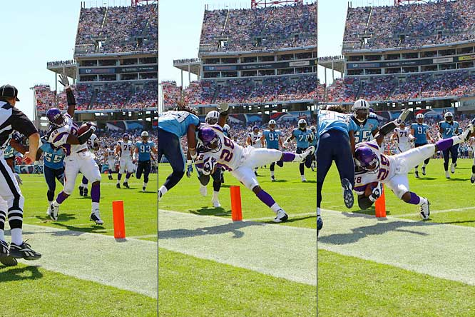 Adrian Peterson scores a touchdown on a 28-yard run as he is brought down in the end zone by Titans safety Michael Griffin in the second quarter of Minnesota's 30-17 loss to Tennessee.