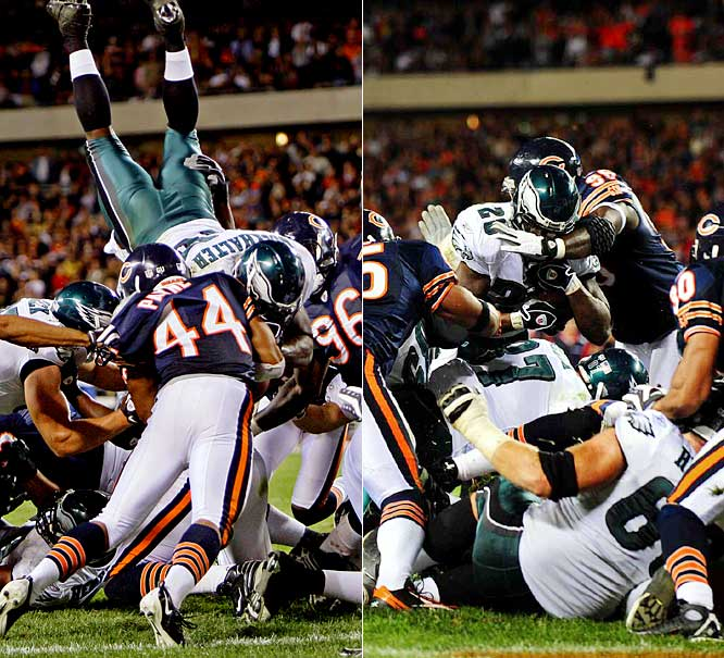 A leaping Correll Buckhalter got stopped a few inches short of the goal line on third down, late in the fourth quarter, and Bears defensive end Alex Brown (96) wouldn't let him go over the top on the next play, dragging him down before he went to the air.  Chicago held on to beat the Eagles 24-20.