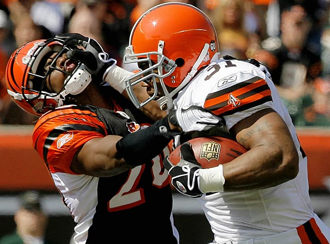Jamal Lewis fights to break free from Bengals cornerback David Jones during the first quarter.  Lewis ran for 79 yards and scored his first touchdown of the season in the Browns 20-12 win.