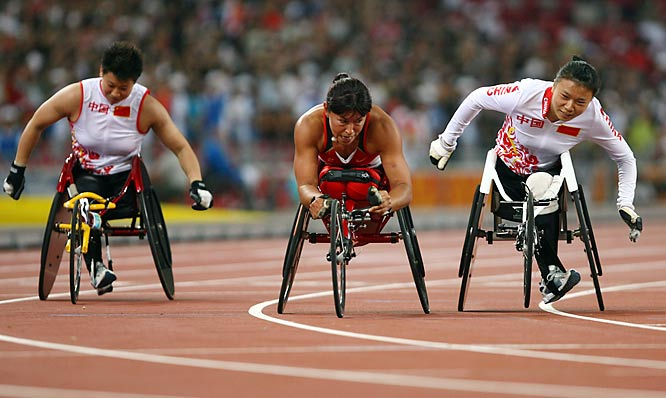 Chantal Petitclerc of Canada (center) leads in the 100.