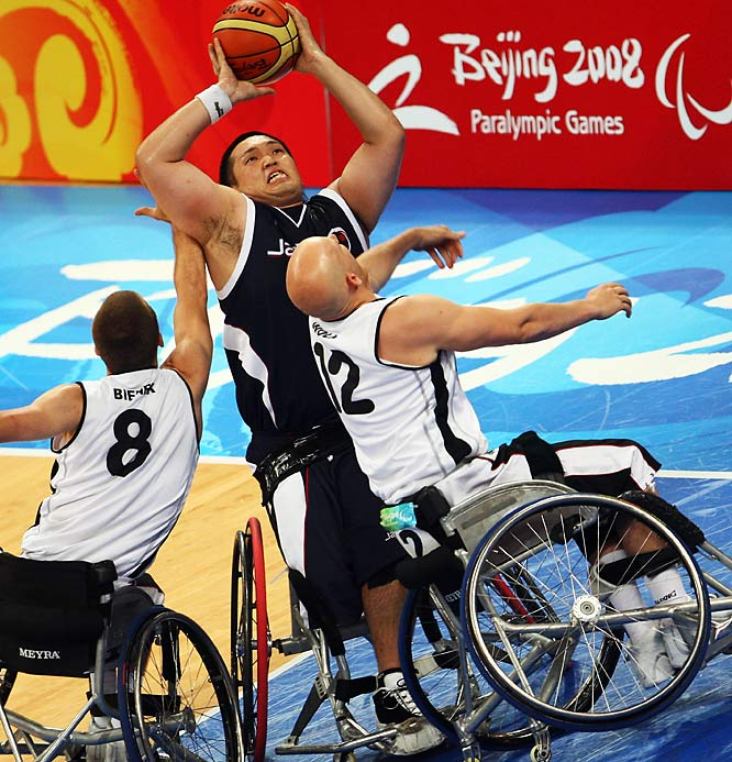 Reo Fujimoto of Japan tries to shoot over Andre Bienek (8) and Sebastian Wolk of Germany.