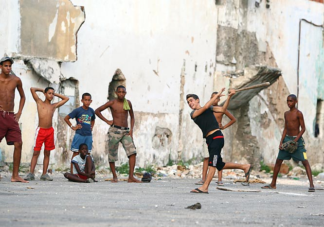 A street baseball game in Old Havana.
