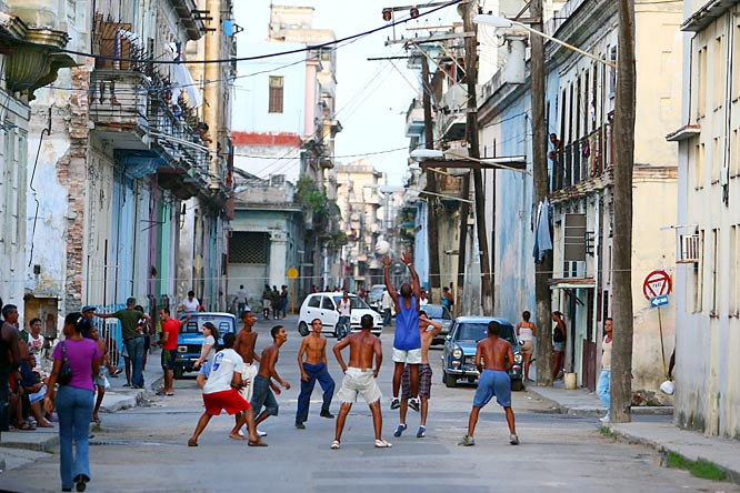 Baseball, soccer and basketball aren't the only sports you'll find being played on the streets of Havana. There are also volleyball games like this one.