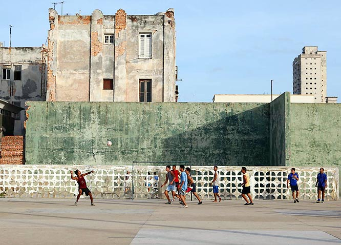The best player on the concrete was an Asian guy in a blue North Carolina Tar Heels T-shirt. (Who knows? Maybe Anson Dorrance is trying to open up a new recruiting territory.) Note the building conditions: the reason Habaneros walk down the middle of the street instead of on the sidewalk, we're told, is that dozens of buildings fall down in Havana each year.