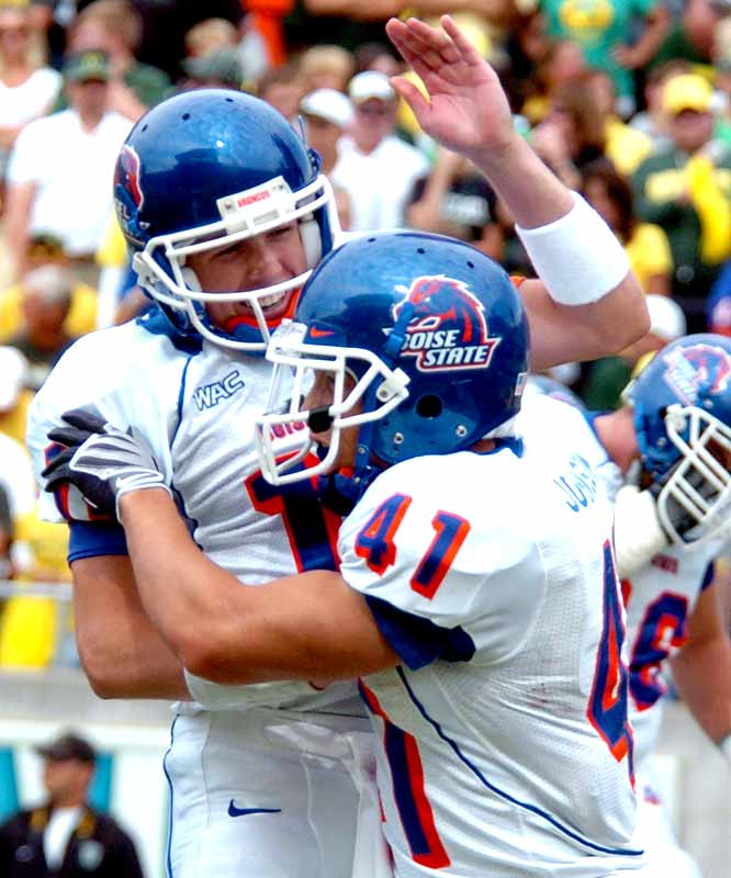 QB Kellen Moore (left) and Ian Johnson accounted for four touchdowns in the Broncos' road upset in Eugene, Ore. With the victory, Boise State can expect its own bump into the top 25.
