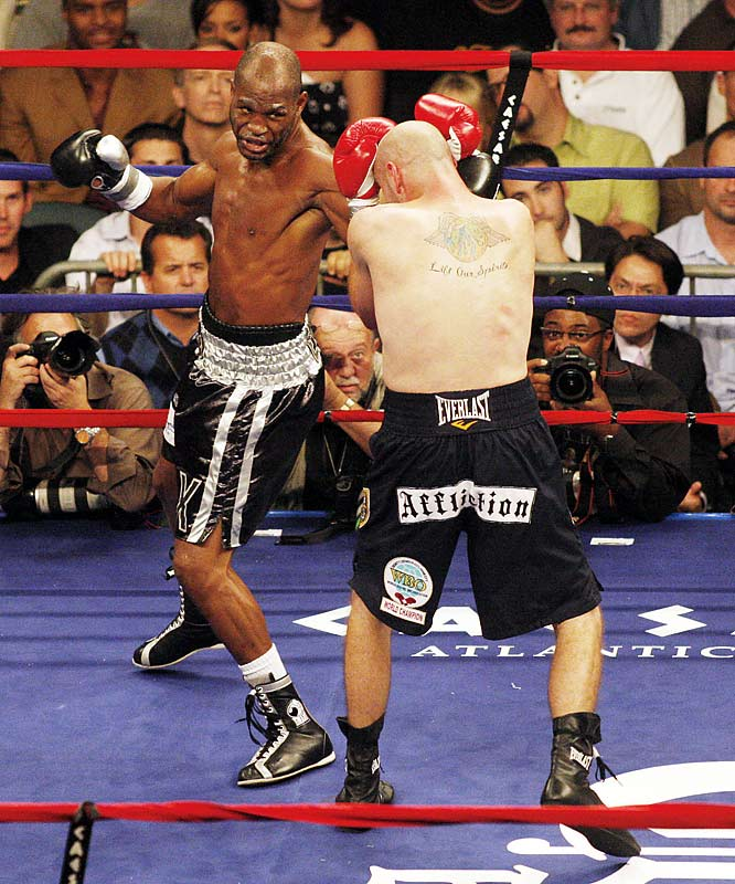 After 43-year-old Bernard Hopkins (facing) defied expectations in beating Kelly Pavlik -- a man 17 years his junior and a top-10 pound-for-pound fighter -- we dusted off the archives to relive some of the best upsets in the ring.