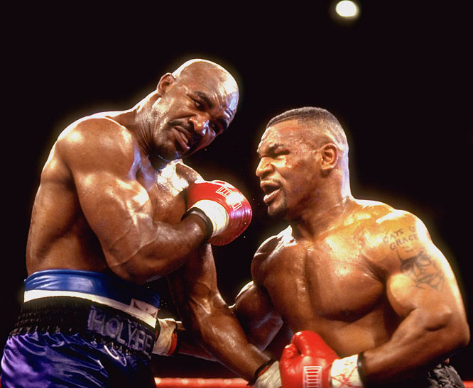 "In Holyfield and Tyson's first meeting (their second included an ear-biting), the undisputed world heavyweight championship was on the line. Reigning champ Tyson had quickly made his way back to the top since retiring in 1994, while the 34-year-old Holyfield was billed as a ""washed-up fighter."" But after Holyfield landed a series of punches in the 10th round and followed with a tough combination in the 11th, the referee stopped the fight. Mr. Washed-up was ruled champ."