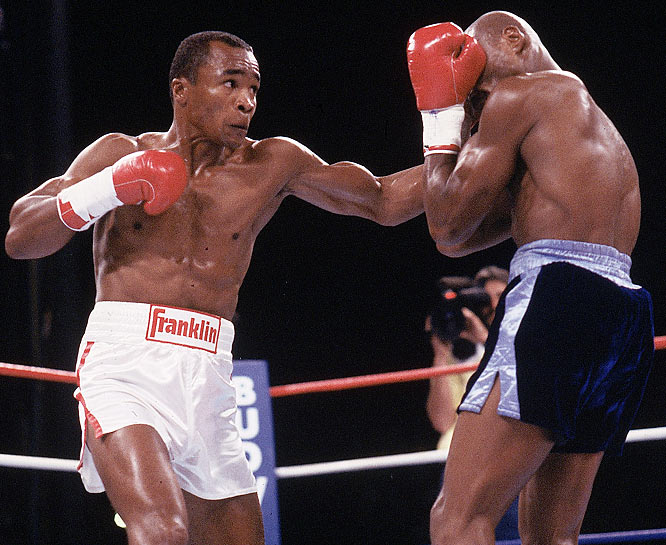 "In his first fight since suffering a detached retina and retiring, Leonard (white trunks) took on World Middleweight Champion, ""Marvelous"" Marvin Hagler -- a shocking choice for Leonard that posed Hagler as the heavy favorite. But Leonard's speed and finesse threw off Hagler, and though neither fighter was knocked down in the match, Leonard won by split decision."