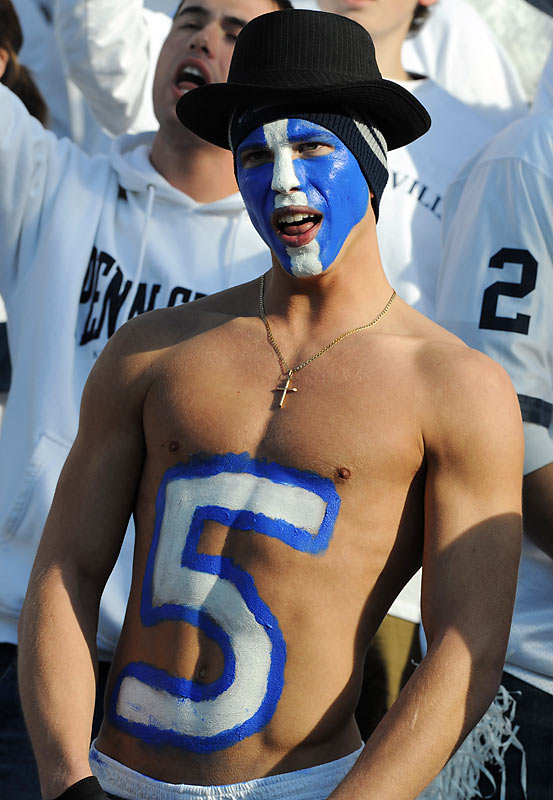 Few things accent facepaint quite like a top hat, as this Penn State fan knows.