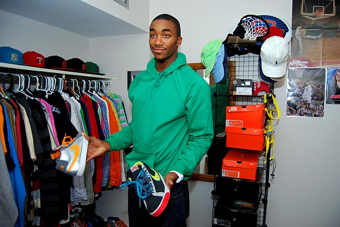 """Johnson's closet boasts not only an impressive shoe collection, but also a fair share of Ralph Lauren polos and baseball caps. You'll find a couple Yankees hats up there, but MJ said he'd never wear one to a Cleveland Indians game. """"I wouldn't do that -- I'm not LeBron."""""""