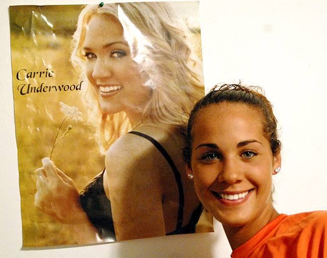 Hall poses with her prized Carrie Underwood poster.