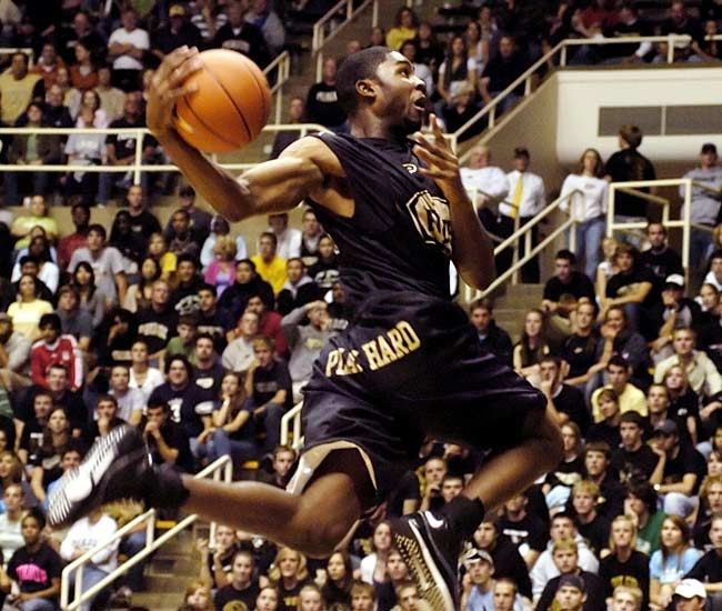E'Twaun Moore flies through the air during the dunk contest at Purdue.