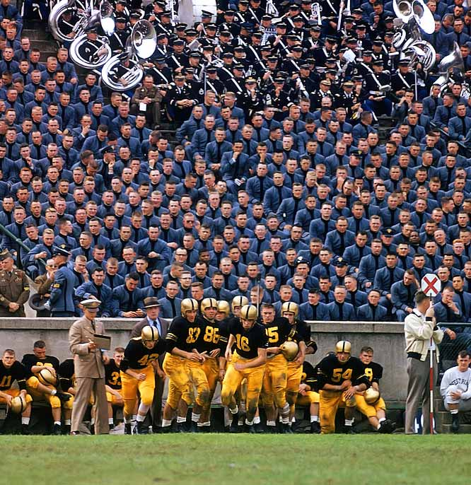 After earning All-America honors in 1954, Army's Don Holleder switched to quarterback in 1955, leading the Cadets to a 14-6 upset of Navy.  In 1967, at the age of 33, Holleder appeared on the pages of SI again, when he was killed 41 miles Northeast of Saigon in the early days of the Vietnam war.