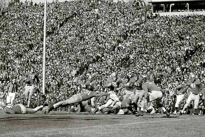 Frank Sinkwich, dubbed Georgia's alltime All-American, goes for eight yards on the way to the Bulldogs' 40-0 thrashing of Tulane.  A few months  later, Sinkwich would lead the Bulldogs to a national championship and he would earn a Heisman.